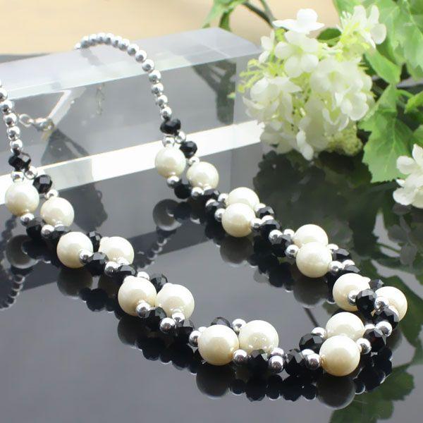 Perles noires + collier en cristal