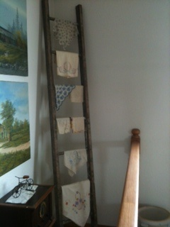 How I display some of my old hankies.  :)   The ladder was out in one of the barns!