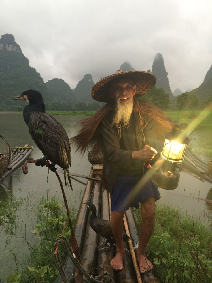 Took this picture on my phone the other day. A cormorant fisherman on the Li River outside of Guilin, China. - Imgur