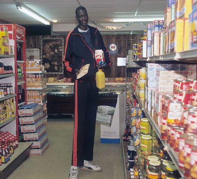 University of Bridgeport center Manute Bol goes shopping for groceries. (Jacqueline Duvoisin/SI)  GALLERY: Rare Photos of Manute Bol
