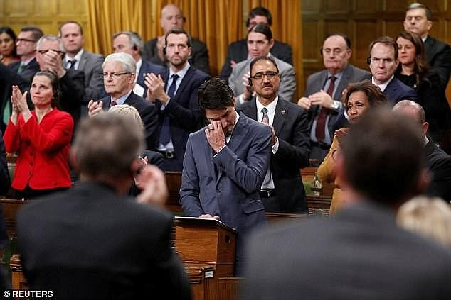 In his magazine profile, Trudeauurged leaders to have candid conversations, and to 'give people a friendly nudge to move forward in the right direction'. He's pictured above speaking in Parliament