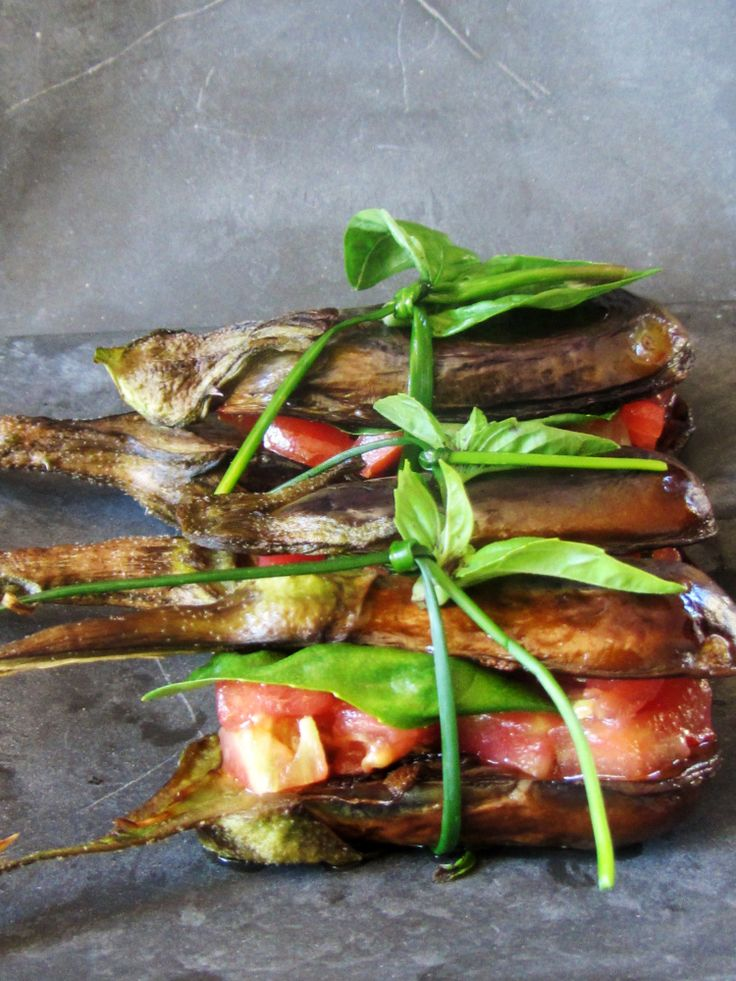 Salad of tomatoes, basil and mozzarella cheese inside the baked aubergine