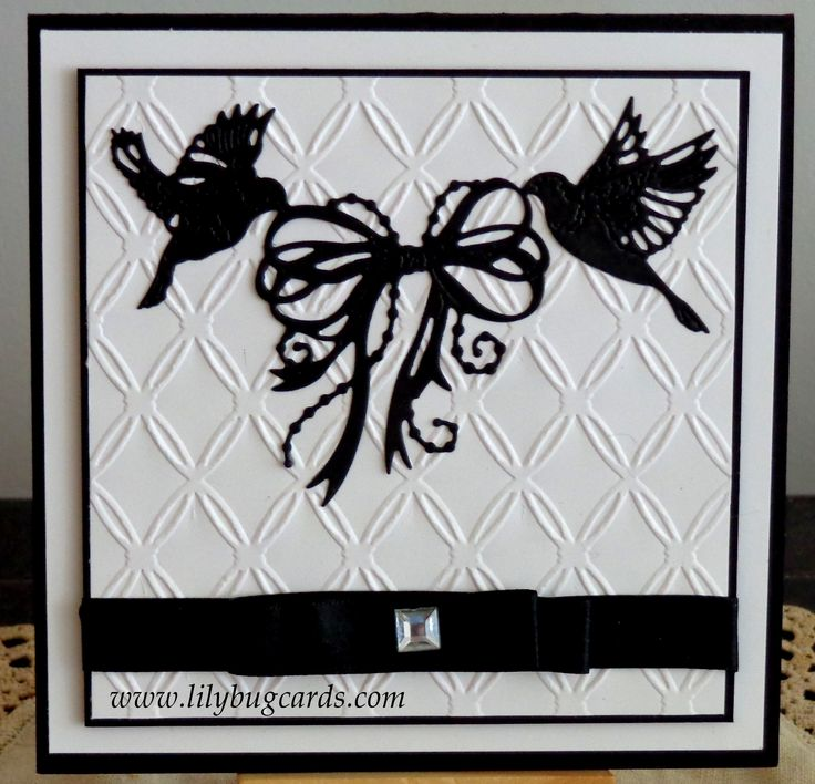 Simple black and white with a beautiful Tattered Lace die and embossed stock.   Also have a rsvp card to match.