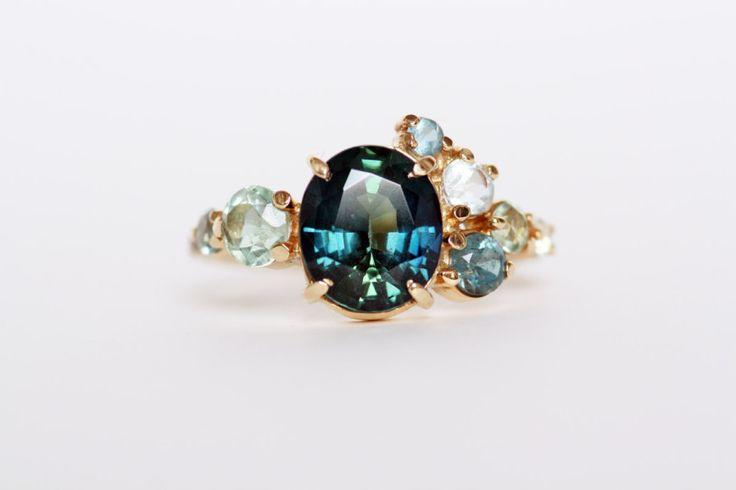cluster ring - collection of amazing rings for those of us who hate diamond engagement rings!