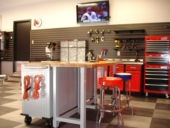 Our functional and organized garagefinally garage for Kitchen cabinets lowes with garage wall art ideas