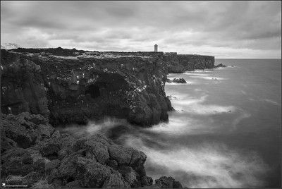 Iceland, landscape, photography, nature, travel, Images Beyond Words, Serge Daniel Knapp, lighthouse, long time exposure, tripod, black and white, cloudy, spray, heavy sea, atlantic ocean, cliff, rocks, hills, art