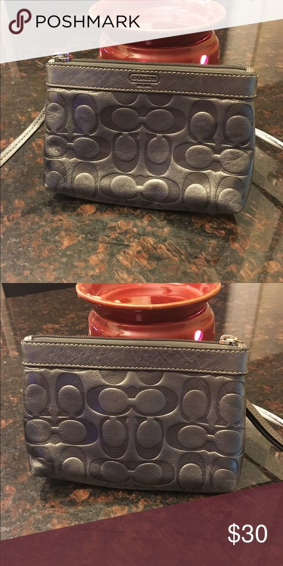 Silver Coach wristlet Cute silver Coach wristlet in great condition. Perfect for anytime of the year! Coach Bags Clutches & Wristlets