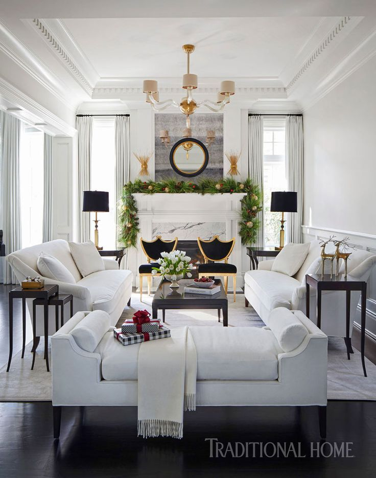 Living room sofas upholstered in ivory velvet pair with chairs with whimsical silhouettes that radiate a golden finish. - Photo: Werner Straube / Design: Soledad Zitzewitz