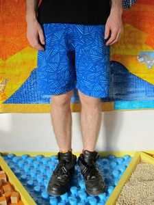 SassiCapra X LaPok Collaboration Hand screen printed drill cotton shorts:  - Two side pockets  - Back pocket  - Elastic waist with cord  HAPPY DAYS! Available: http://sassicapra.bigcartel.com/product/rock-face-shorts