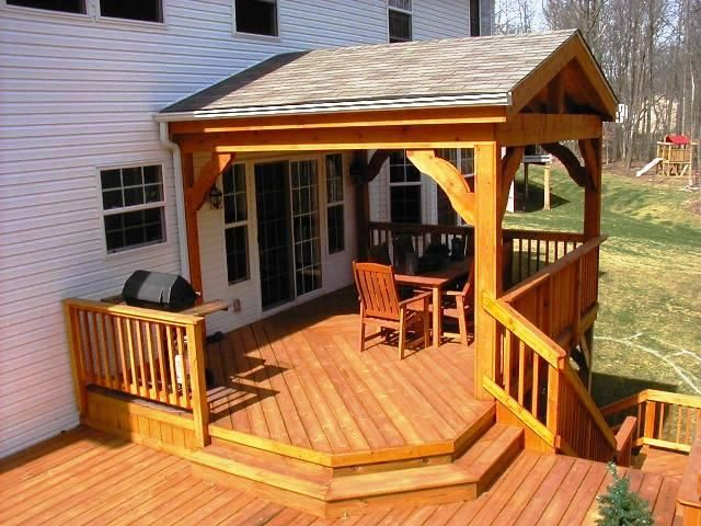 This gorgeous 2nd Story Open Porch and Deck features Cedar wrapped columns, roof beam and Railings with Pressure Treated Pine Decking. Note the curved bracing on porch. This custom design was built in Columbus, Ohio, Delaware County
