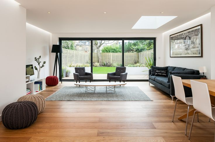 Updating this modern home to incorporate large strip roof lights and fully glazed doors to the garden for a slick, contemporary look | UV Architects