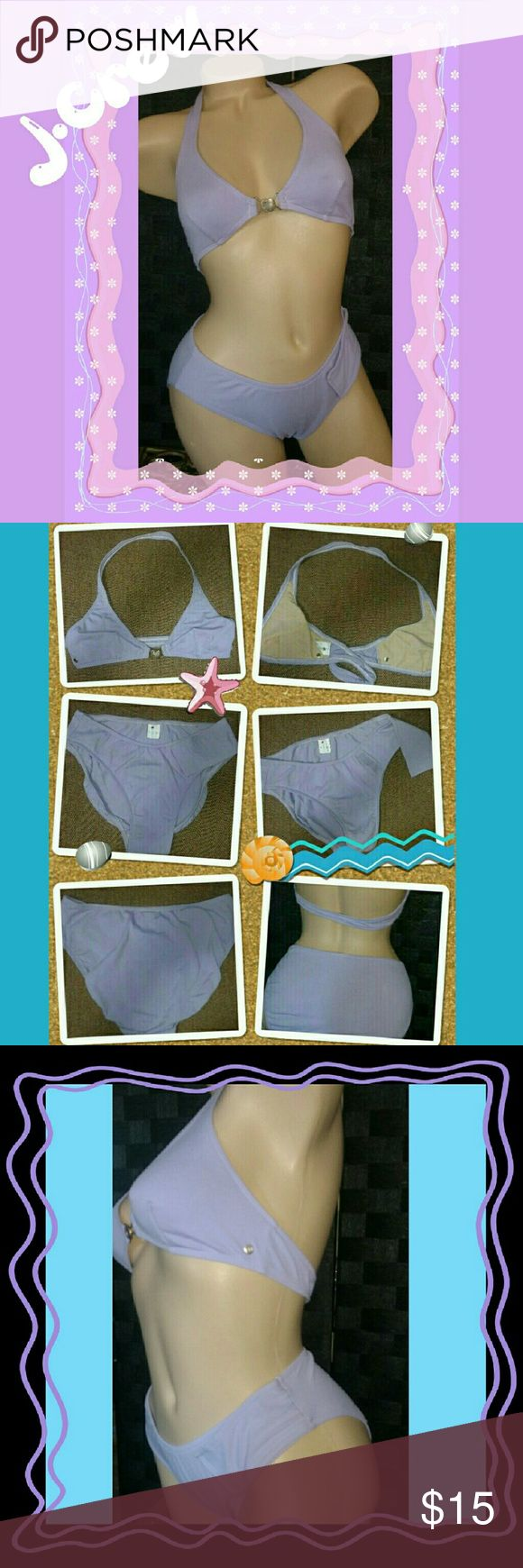 NWOT J Crew halter bikini medium New, light violet, medium, 2 piece bikini by J. Crew. Halter style bikini top, front closure with silver toned hardware. Bikini bottoms have hi cut thighs with a Velcro closure flap and a hidden interior panel to assure a smooth sexy look. J. Crew Swim Bikinis