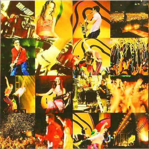 Sandy & Junior #Ao vivo no maracanã 2002 : Chateada # Vocês não leem o que eu escrevo ;( Magoada .. Eu adoro esse cd é muito magico e legal ouvir 70 mil pessoas cantando as musicas da dupla .. Amo a super -heroi -cai a chuva - como é grande o meu amor por você quer dizer todas ... ------------------------------------------------------------------------------------------------------------------------- Adoro essa foto da Sandy tocando violão muito linda ,ju tocando saxfone muito charmoso e ...