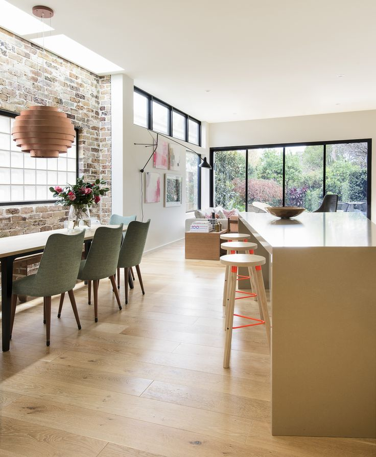 An open place space using furniture and lighting to define the rooms.