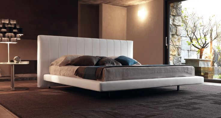 ALUN UP - A simple and elegant bed. The bed Alun has a sober and elegant, has a head on the floor and a raised bed frame, featuring a classic vertical crease.