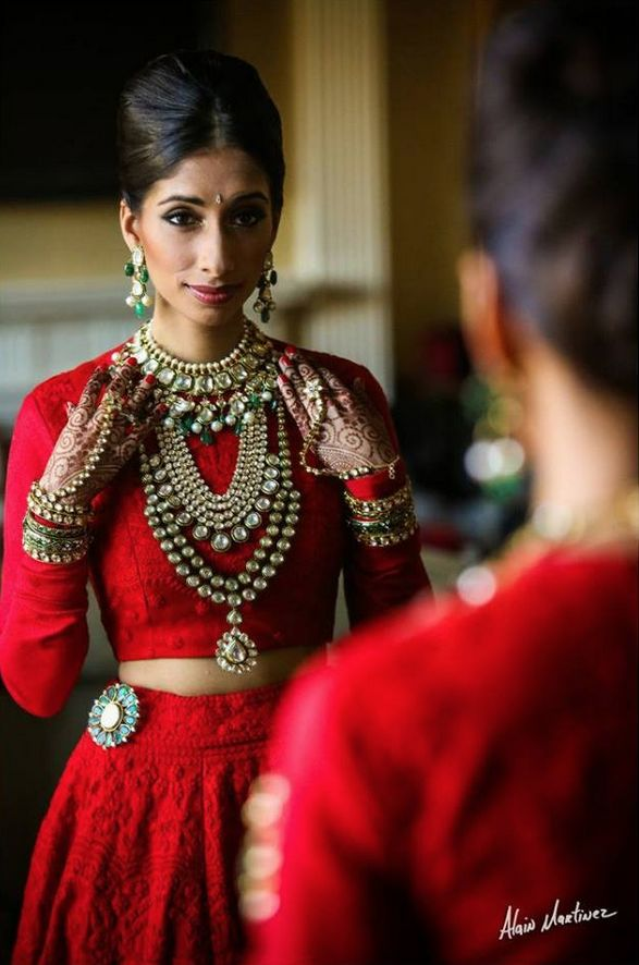 Photo by:Alain Martinez Indian bride... love the all red, long sleeves, layers of necklaces, the hair, the earrings.. love it all.