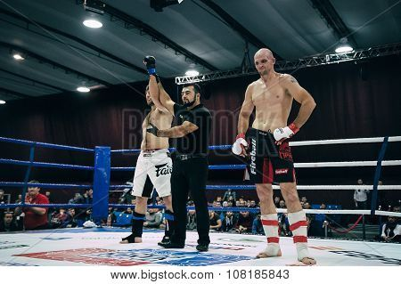 referee announces victory of MMA fighter