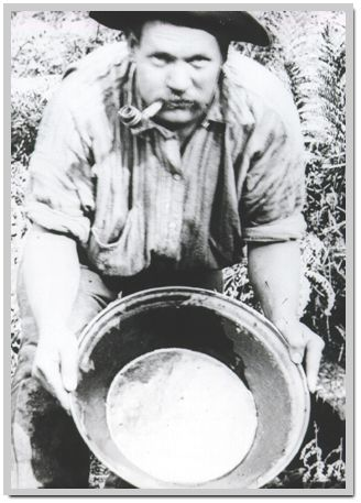 Goldpanning at Gembrook Victoria Australia in the 1890s. The miner swirls gold-bearing sludge in the pan with water, allowing fine gold fragments to settle in the corner of the dish.