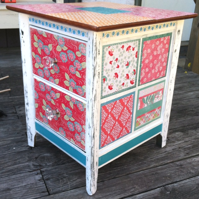 DIY end table I made for our daughter McKinly who will be arriving in June. It looks great in her nursery. Best project I have ever done.... Used scrapbook paper and modge podge and paint and sander.