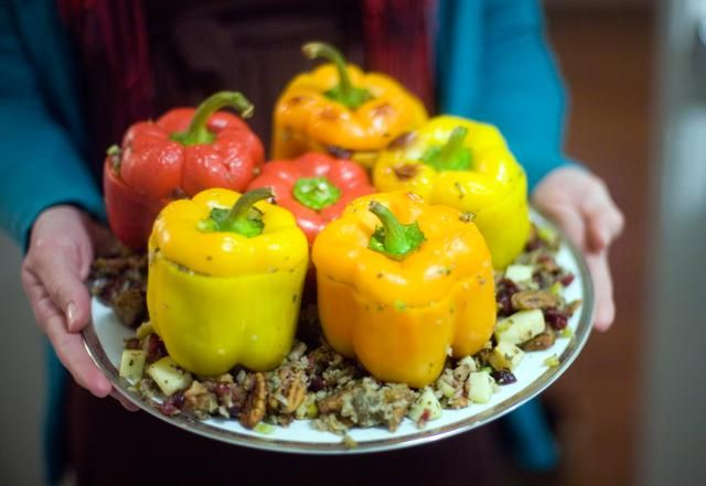 Combine your cheddar cheese and rice along with other ingredients to make these simple stuffed peppers using a saucepan.