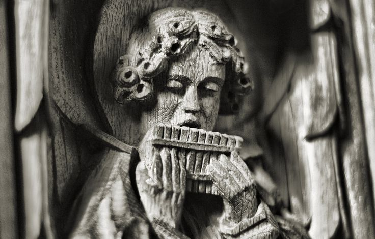 https://flic.kr/p/U1tTxc | The Pipes of Peace | A shot of a Carving in one of the Benches at the Anglican Cathedral.