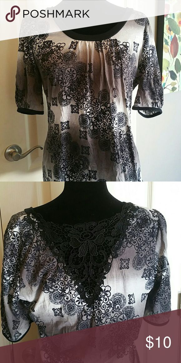 Dress Barn Black and white Top. Lace Back Short Sleeve Black and white.  Can be worn casually or professional. Dress Barn Tops
