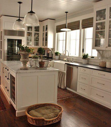 white kitchen + marble + soapstone + wood flooring