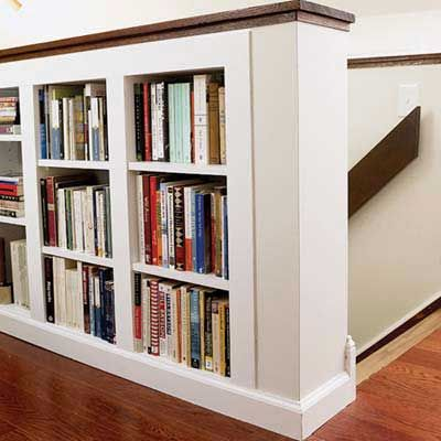 mini built in bookshelves @ stair half wall