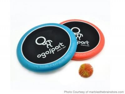 """Have a Ball! Help them burn off some that energy with these cool, lightweight hand trampolines from Ogosport. Your kiddo can bounce the koosh ball back and forth with a partner or play solo—either way he'll get a great workout and boost hand-eye coordination. Bonus points: the disks double as Frisbees!  Ogosport Mini Disk 12"""" from marblesthebrainstore.com"""