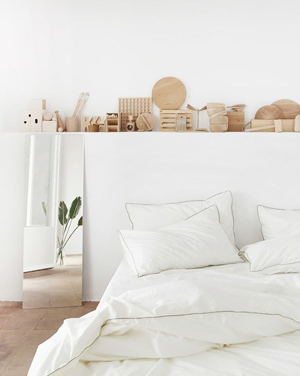 all white bedroom with wooden accents