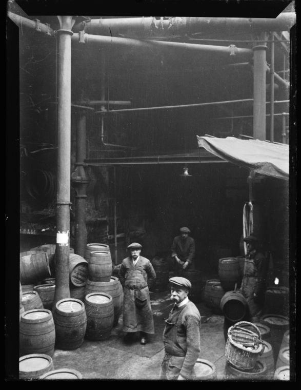 Men at Work in the London Brewery, in 1900, now in 2015 legal drinking age for alcohol is 16, distilled alcohol is 18