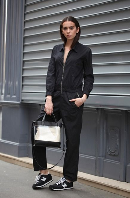 Shop this look on Lookastic:  http://lookastic.com/women/looks/black-jumpsuit-transparent-rubber-tote-bag-black-and-white-suede-low-top-sneakers/9118  — Black Jumpsuit  — Transparent Rubber Tote Bag  — Black and White Suede Low Top Sneakers