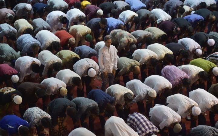 Indonesian Muslims offering prayers on the third night of the holy month of Ramadan at the Istiqlal grand mosque in Jakarta.