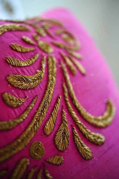 Gold and pink embroidered pillow.