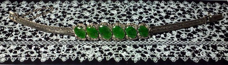 Antique jade white gold bracelet. Dark jadeite jade on white gold, set in the style of an Omega watch strap. SGD$5500