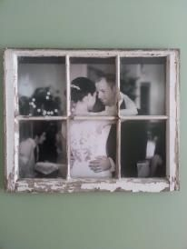 This is an old barn window that I rescued from the trash... re-purposed as a frame for our first dance wedding photo <3
