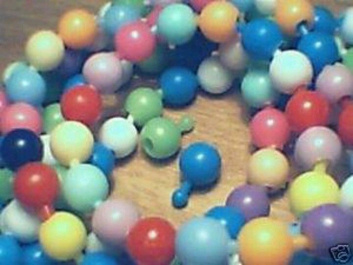 Pop beads! these weren't a kids toy. We actually wore them.