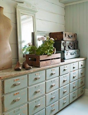 I LOVE this vintage cabinet! Not only is it practical, with all the storage but it is soooo gorgeous with the pale paint color, vintage pulls and natural wood top.