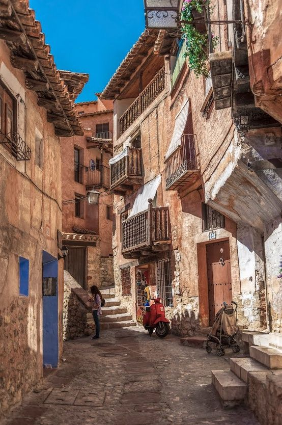Albarracin, Aragon, España.. always have wanted to go somewhere to ride scooters down the streets:)