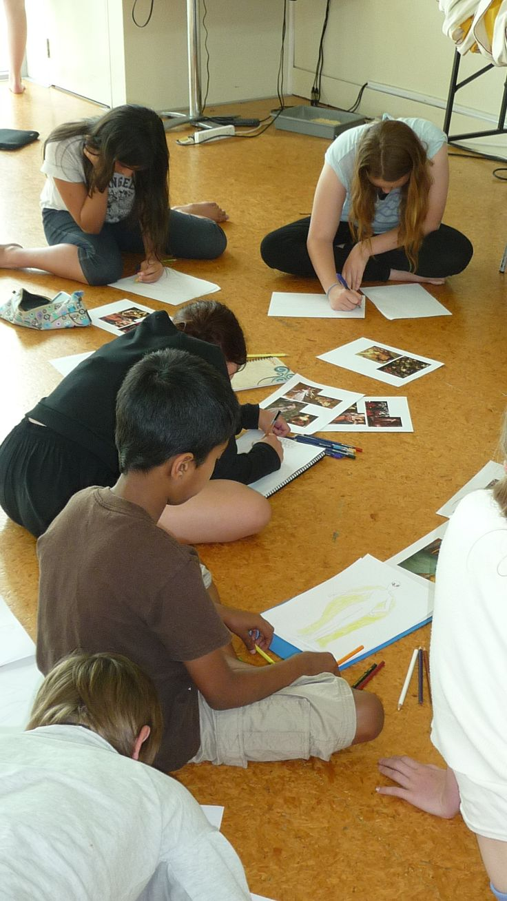 Youth Theatre ages 11 - 13 (costume design). Students in class at TAPAC work on a costume design