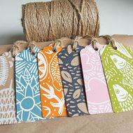 Beautiful gift-tags, hand-printed original assorted linocut designs (Tutti Frutti pack) on 100% recycled card together with a natural jute string. Each pack contains 6 tags carefully selected to give an assorted balance of colour and designs. The photo...