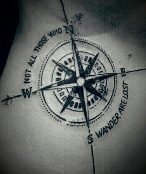 Compass Tattoo with Quote Not all those who wander are lost on hip