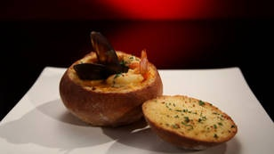 Seafood chowder served in a cob loaf