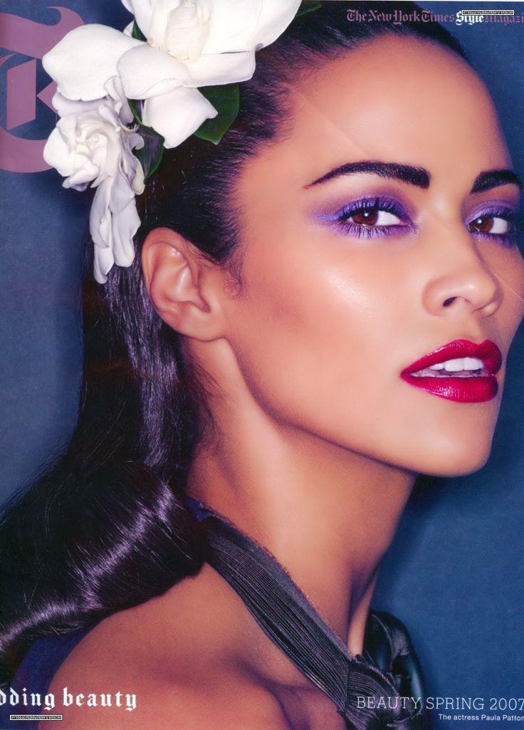 Purple eyeshadow. Red lips.  Paula Patton.