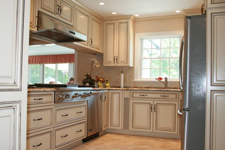 Charmant White Painted Cabinets With Grey Glaze.