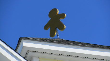 The mascot gingerbread on top of the Gingerbread Construction Company in Wakefield, Massachusetts