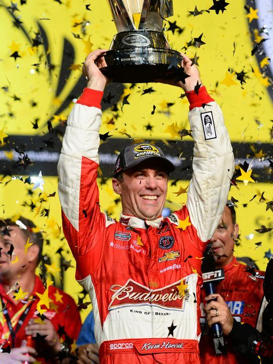 Kevin Harvick lifts the 2014 Sprint Cup in Victory Lane at Homestead-Miami Speedway
