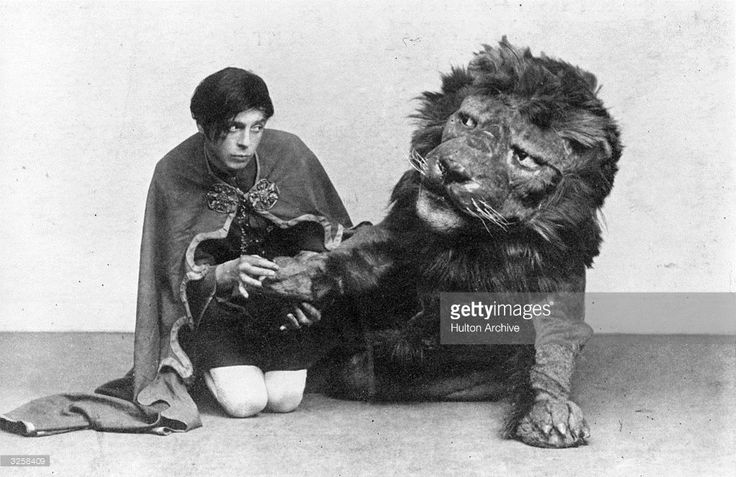 An actor playing the slave Androcles extracts a thorn from the lion's paw in a production of George Bernard Shaw's 'Androcles and the Lion', based on the Roman legend. Playwright: George Bernard Shaw