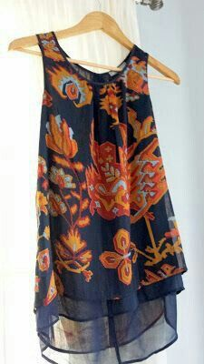 Love the color combo and pattern! I would wear a sleeveless top like this with a sweater to work