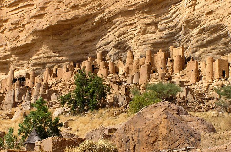 The Bandiagara Escarpment is a sandstone cliff in the Dogon country of Mali that rises almost 500 meters (1,640 ft) from the lower sandy flats below. These cliffs are dotted with ancient cave homes of the Tellem people.
